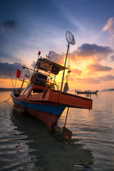 Long tail boat at sunrise in Thailand.
