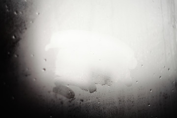 Blurred drops background.Rainy window with space for your text.