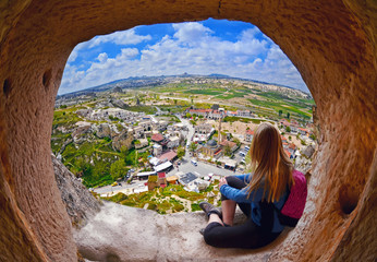 Woman looking into the distance against the background of incredible landscape with  mountains , geological structures in Goreme, Cappadocia,  Turkey Wall mural