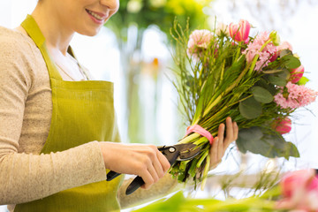 close up of florist woman with flowers and pruner