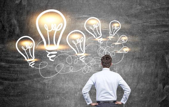 Idea concept man and lightbulbs