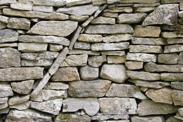 Curved circular texture pattern in a dry stone wall