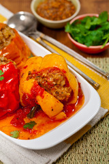 Baked Stuffed Red Bell Pepper with Meat and Rice. Selective focus.