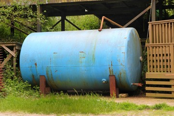 Old metal farmyard tank