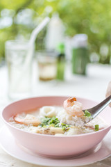 Boiled rice seafood with shrimp, squid, snapper or mush delicious breakfast Thai food.