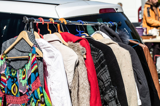 rack of female second hand clothes for donation or charity