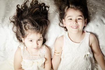 Little sister on Silky bed inside bedroom