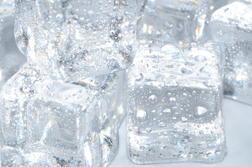 Macro detail of ice cubes with water droplet