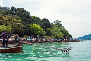 Traveler boats parked arrange on Lipe island, Thailand