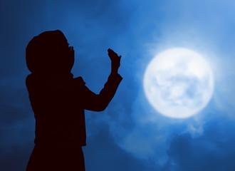 Silhouette woman praying