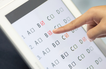 student testing in exercise, exams answer on a tablet with multi