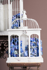 white wooden bird cages with blue hydrangeas