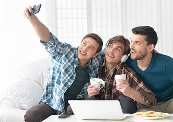 men having fun taking selfie photo