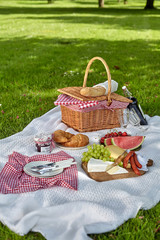 Healthy picnic food with fruit, cheese and bread