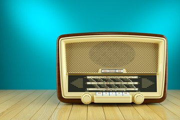 Retro radio receiver on wooden table blue background 3d