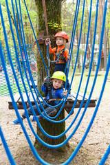 Little climbers takes the rope bridge