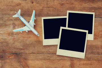 blank instant photos album next to cup of coffee and airplane