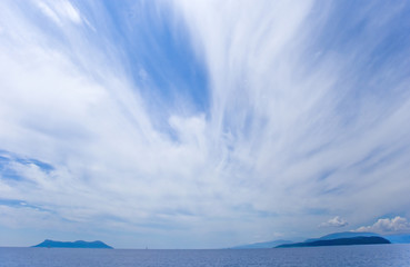 Beautiful clouds over the islands and the sea