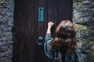 Woman knocking on door