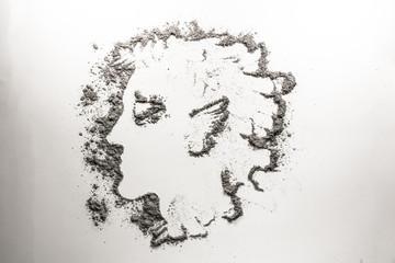 Myth man head drawing in grey ash, dust, dirt