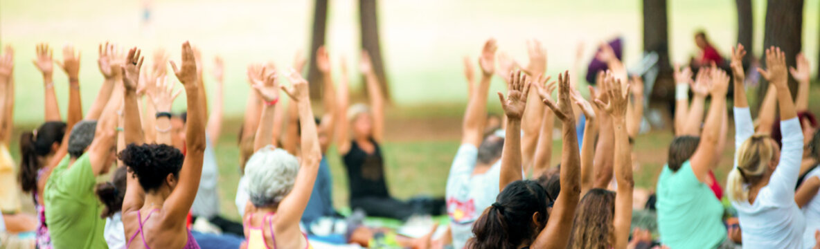 banner of hands up of people doing yoga