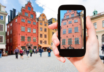 tourist photographs old house in stockholm