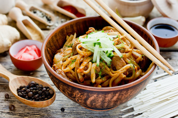 Japanese fried udon with pork in spicy ginger sauce