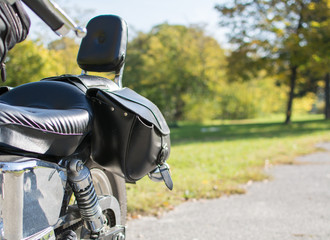 Motorcycle saddlebags close-up. Leather ones. Where to travel?
