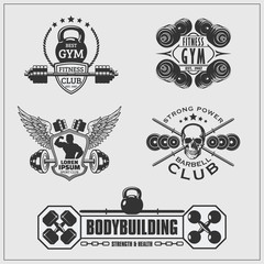 Set of gym emblems, labels, badges and logos.