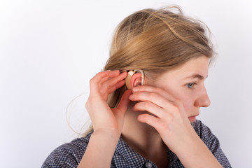 Young girl with hearing aid