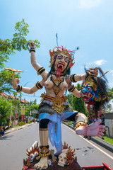 Colored traditional Nyepi sculpture behind a lorry in Bali. Indo