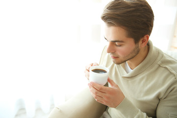 Handsome man drinking coffee in the morning