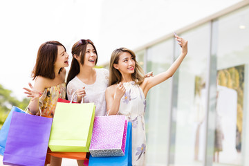 happy young Women Taking  Selfie while Shopping