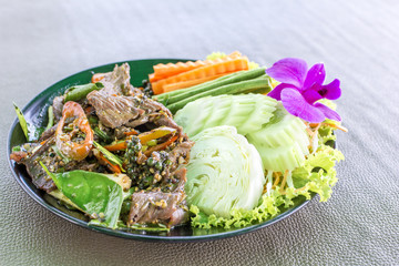 Stir fry beef spicy meat with herb and vegetable delicious Thailand food.