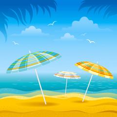 Beach background with blue sea and stripped beach beach umbrellas.