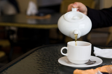 cup and teapot in cafe