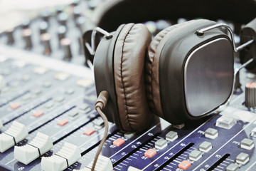 close up of Headphones on sound mixer background