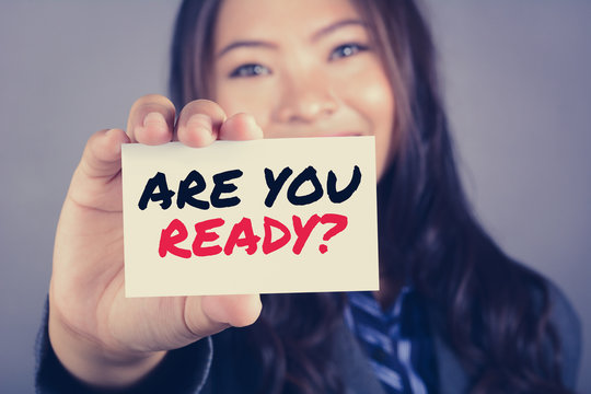ARE YOU READY? message on the card shown by a woman