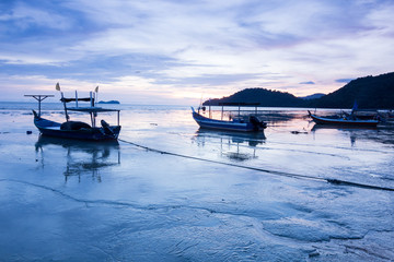Sunrise and Sunset with by the beach with a boat in Penang Malaysia