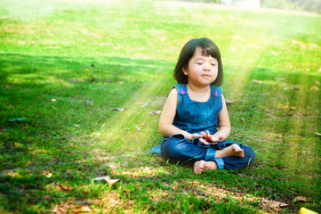 Meditating girl with light