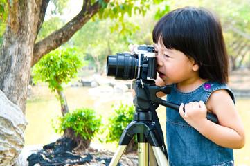 Little girl take photograph outdoor