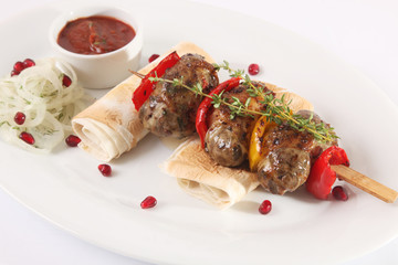 Sausages on a skewer with pita and sauce