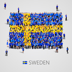 Large group of people in the Sweden flag shape.