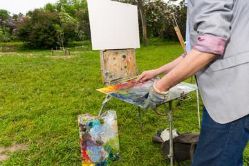 Painter Preparing To Paint