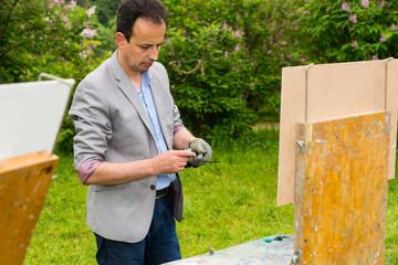 Painter Squeeze His Paint
