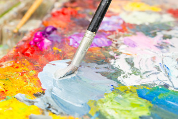 Professional paintbrush mixing colors