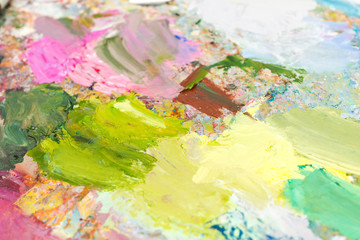 Bright blended oil paint on a palette