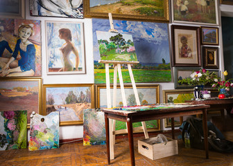 Painters studio with colorful canvases