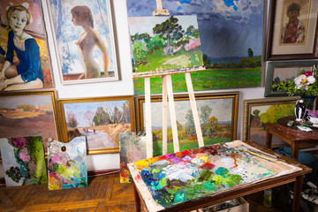 Professional artists studio with colorful canvases