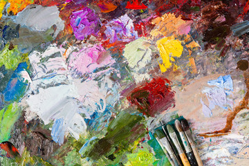 Multicolored palette with paintbrushes